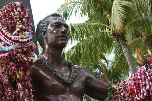 Duke Kahanamoku was a 5-time Olympic medalist in swimming and instrumental in spreading the sport of surfing across the world.