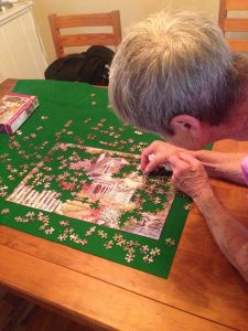 My mum working diligently on the jigsaw puzzle...