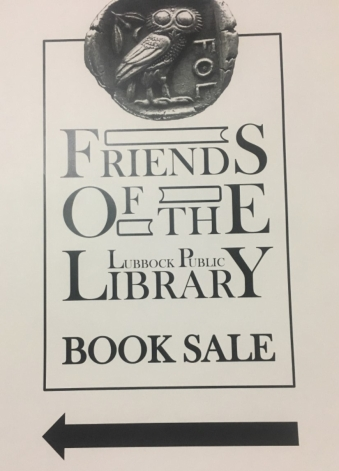 Sign of arrow pointing to the library sale.