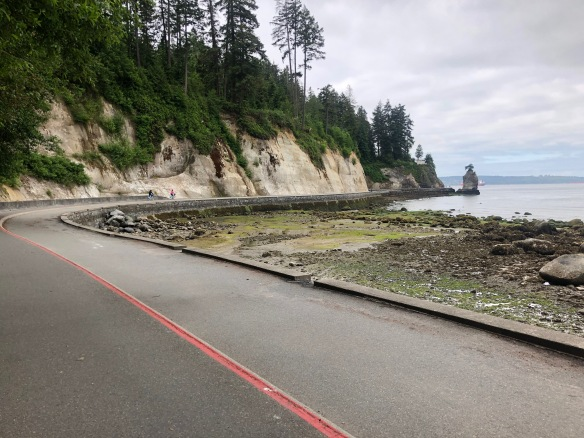 Pic of bike-rider view of coastal bike path that hugs edge of Stanley Park.