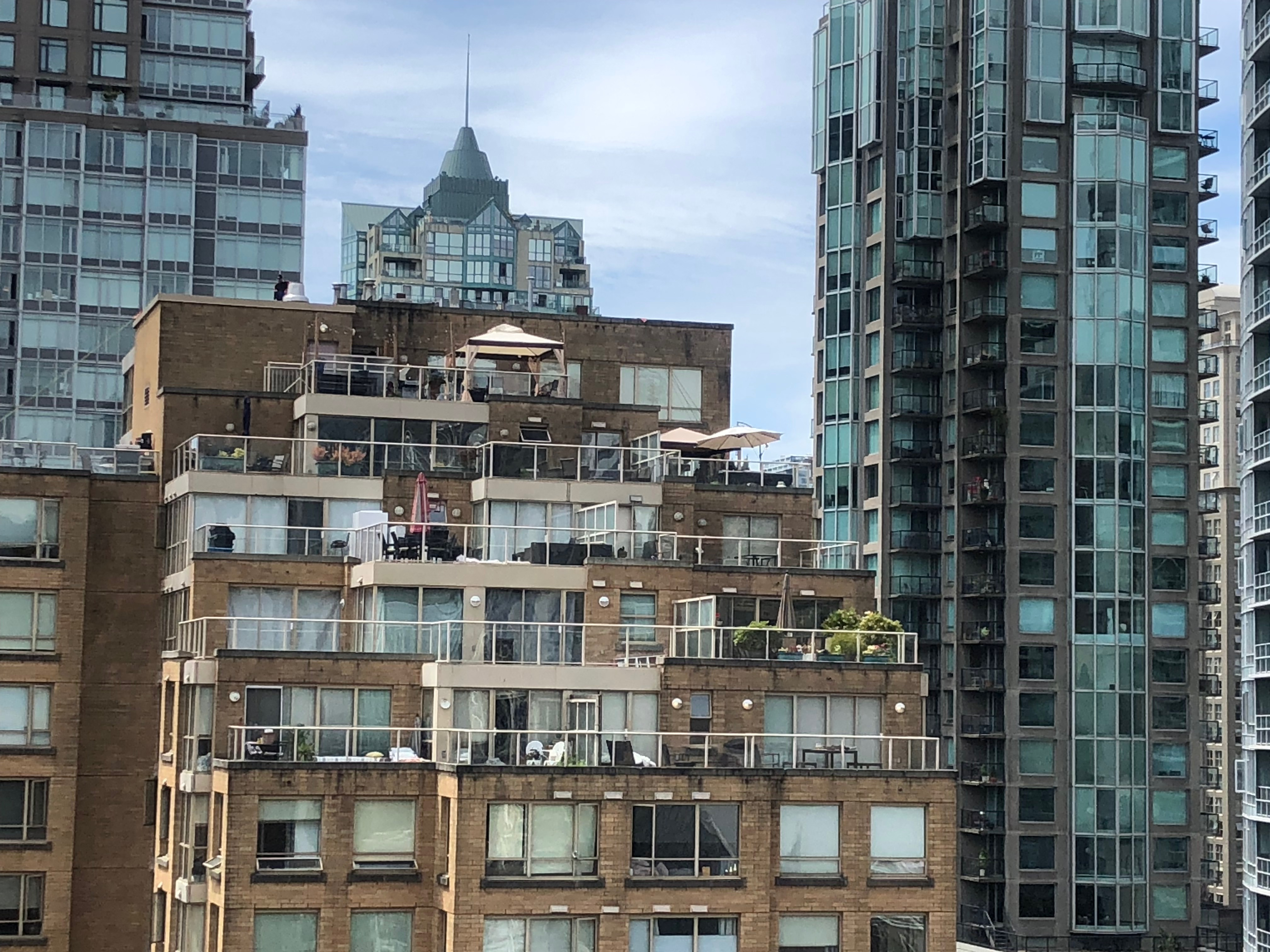 View from one perspective of the VPL rooftop garden. (Pic of close-by residential building with gardens and balconies on high stories.)
